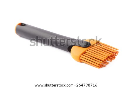 Silicone oil spreading brush for cooking isolated over the white background - stock photo