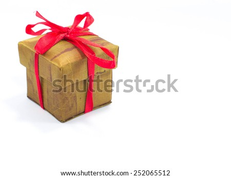 Silk box with red bow ribbon - stock photo