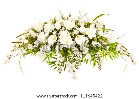 Silk casket cover funeral flower arrangement - stock photo