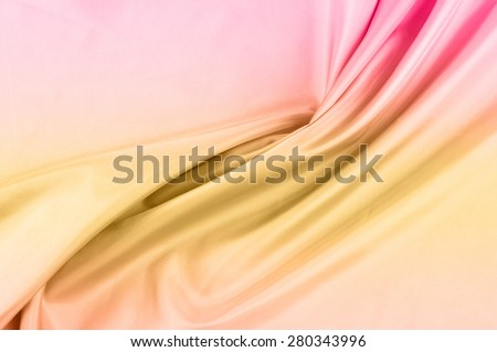 silk cloth, the color Coral. texture silk cloth. Deluxe silk cloth background with waves and drapery. Backdrop for fashion luxury design. coral color  silk fabric - stock photo
