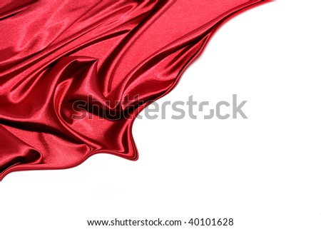 Silk flowing on white background. Copy space.
