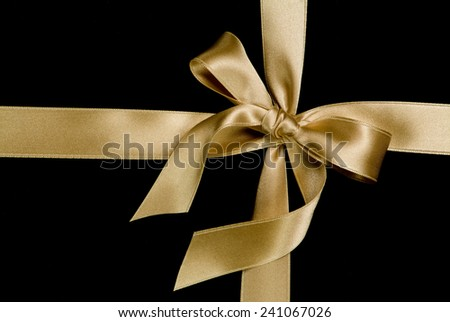 silk golden ribbon on black - stock photo
