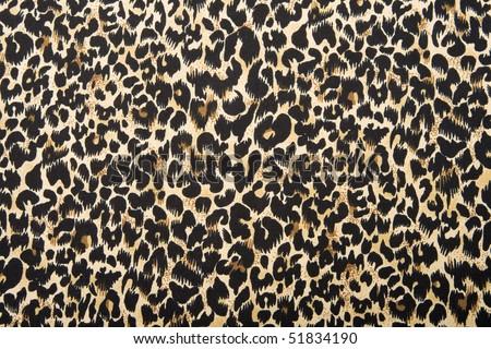 Silk leopard print fabric. - stock photo