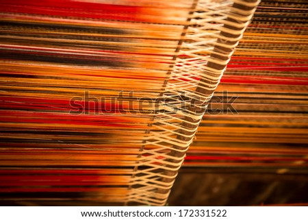 Silk on the loom - stock photo