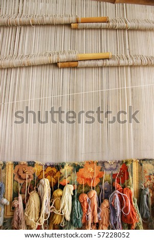 Silk rug weaving on a hand loom in China - stock photo