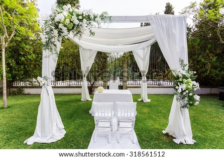 Silk tent for the wedding ceremony for the newlyweds. The garden in the countryside. - stock photo