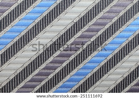 Silk tie with colored diagonal stripes. Natural fabric material.   - stock photo