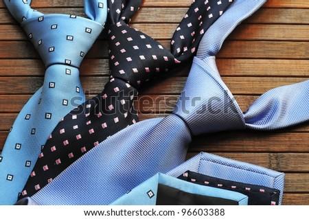 Silk ties on wooden background - stock photo