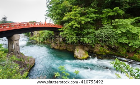 Silk water, long exposure of Shinkyo Bridge in Nikko, Japan. Rear view - stock photo