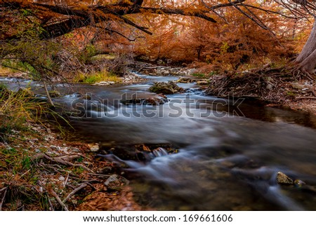 Silky Flowing Waterfalls Along the Guadalupe River Surrounded by Beautiful Fall Foliage, Texas. - stock photo