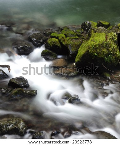 silky smooth jungle stream in an idyllic dream like environment - stock photo