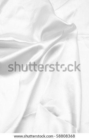 silky smooth white satin background with shine, folds, creases and copyspace. - stock photo