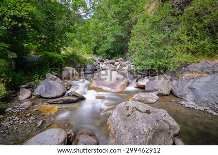 Silky water flowing in a river in the middle of a wild forest, Spain - stock photo