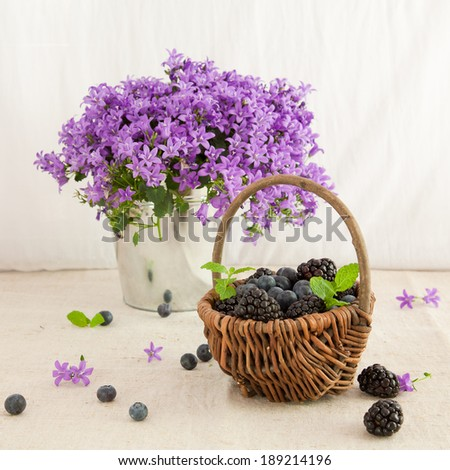 Sill life with berries and flowers - stock photo