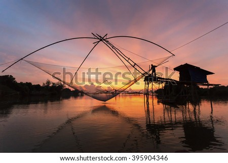 Sillhouette and Thai style fishing trap in Pak Pra Village, Net Fishing Thailand, Thailand Shrimp Fishing, Phatthalung, Thailand. - stock photo