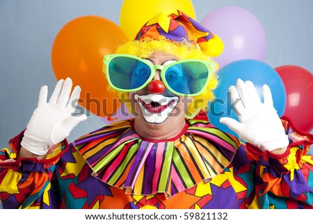 Silly clown in oversize glasses, making a surprised face. - stock photo