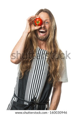 Silly fun portrait of a man with a tomato over his eye laughing. Isolated on white. - stock photo