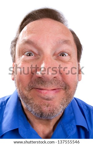 Silly funny senior adult man smiles with a humorous expression on his face. - stock photo