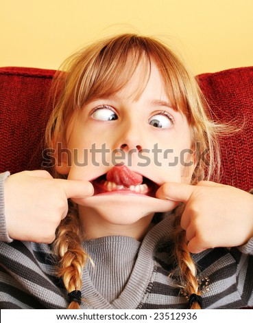 Silly girl face with expressive eyes - stock photo