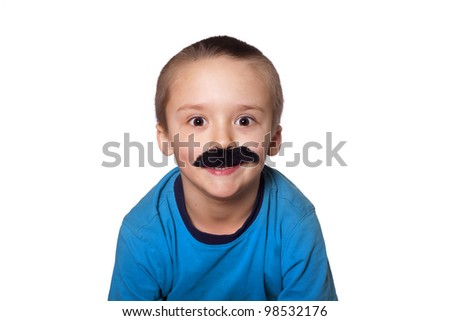 Silly toddler wearing a big fake mustache. - stock photo
