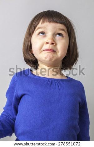 silly 4-year old child playing with her face and eyes for expressing happiness - stock photo