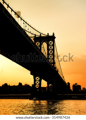 Silohuette of the Manhattan Bridge in New York at sunset - stock photo