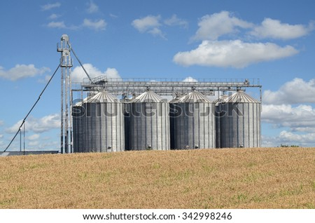 Silos and farmland in eastern Europe - stock photo