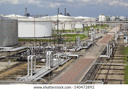 Silos and pipes of an oil refinery plant in Rotterdam, Holland - stock photo