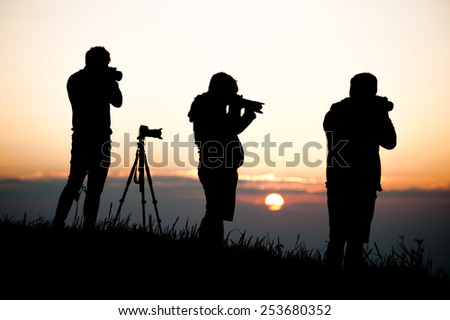 silouette man taking photo of sun rise - stock photo