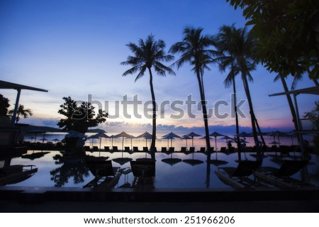 Siluette of a beautiful sunrise on the beach - stock photo