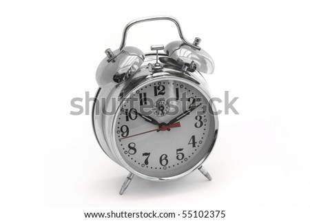 silver alarm clock on a white background - stock photo