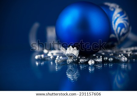 Silver and blue christmas ornaments on dark blue background with space for text. Merry christmas card. Winter holidays. Xmas theme. - stock photo