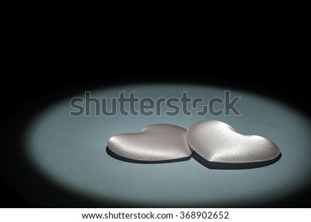Silver and delicate hearts. - stock photo