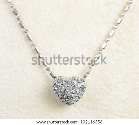 silver and diamond necklace on display - stock photo