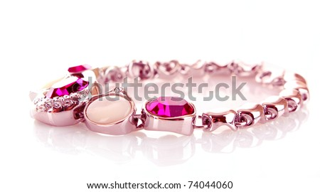 silver and diamonds bracelet with pink stones on white background - stock photo