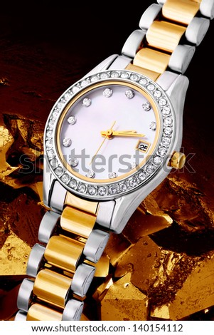 Silver and gold exclusive watch - stock photo