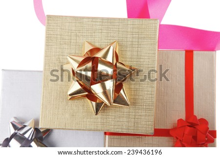 silver and gold gift boxes with pink bow isolated over white background - stock photo