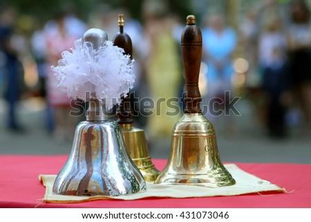 Silver and gold handbells - stock photo