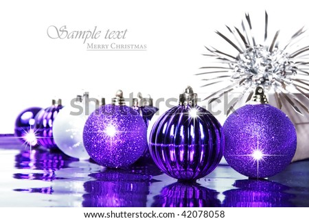 Silver and purple christmas decorations with space for text - stock photo