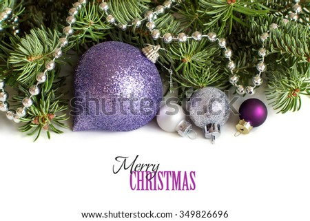 Silver and purple Christmas ornaments border on white background
