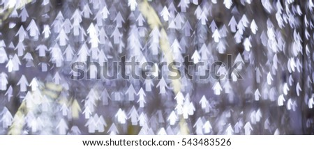 silver and white bokeh lights defocused. abstract background.