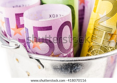 silver basket full of big euro banknotes on white background - stock photo