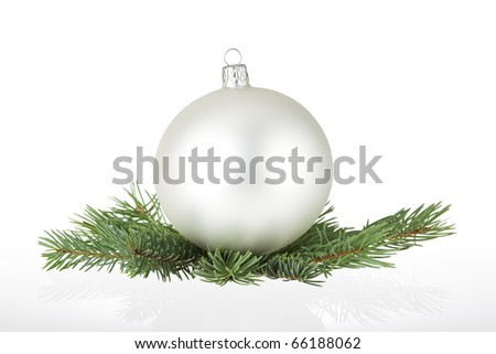 Silver bauble and spruce branches with reflection on white. Clipping path. - stock photo