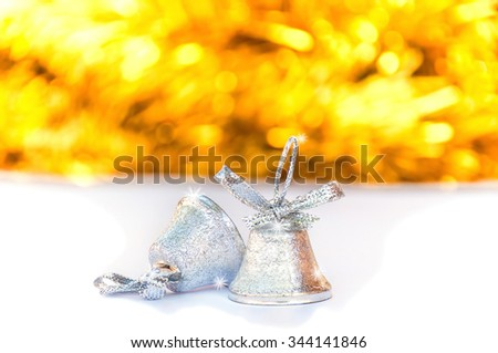 Silver bells with blur shiny yellow stripe and white background, Christmas decoration object - stock photo