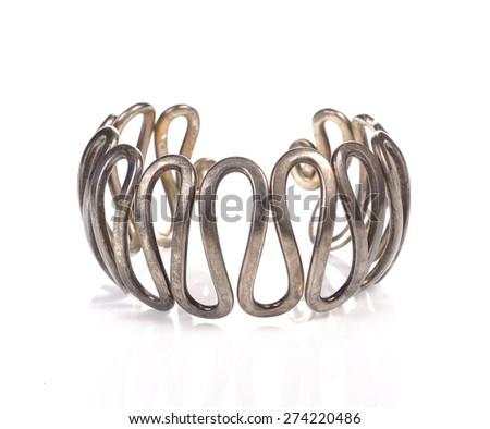 Silver bracelet on white a background - stock photo
