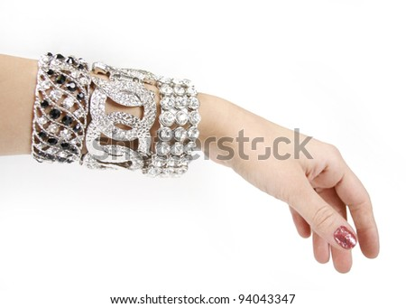 Silver bracelets on woman hand on a white background - stock photo
