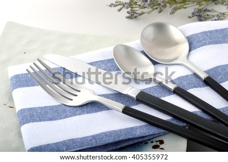 Silver brushed stainless steel knife and fork spoon - stock photo