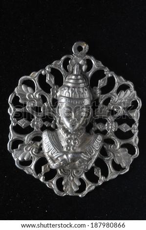 Silver Buddha Pendant Jewel over a Black Background - stock photo