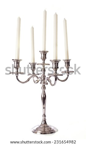silver candelabrum in front of white background - stock photo