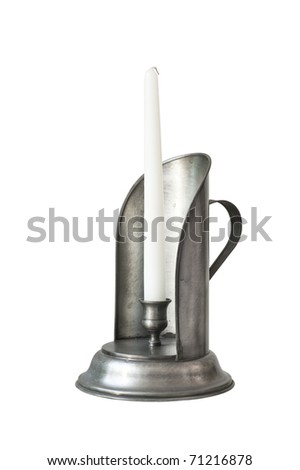 Silver candlestick with white candle isolated on white background